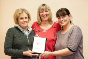 Bradford Volunteer Co-ordinator Jeanette Procter, centre, with volunteers Angela Clark (left) and Laura Kelsall (right) with our IiV plaque