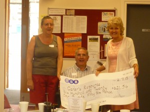 Grace and husband Keith present Fundraising Co-ordinator Anne Wells with their donation