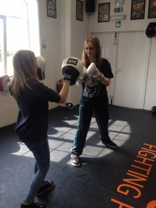 Overcoming stress ...young carers Kira (left) and Aimee try out the new boxing sessions