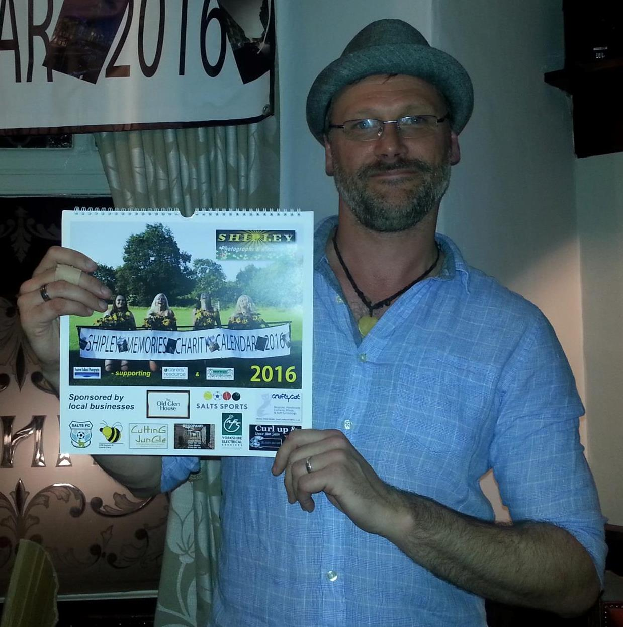 Photographer Andrew Holland with the new calendar