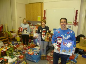 Pictured with gifts and hampers are Young Carer workers (left to right) Hettie Flynn, Laura Frith and James Woodhead-Dixon.