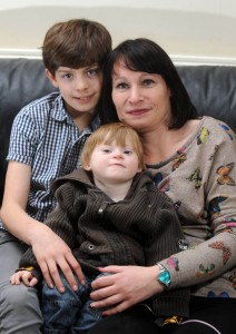 Callum, mum Lisa, and Alfie at home in Cross Hills. Photo courtesy of Yorkshire Post.