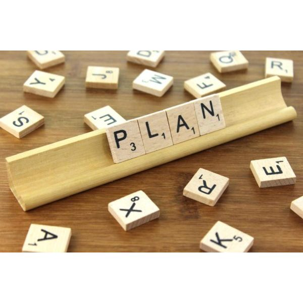 Scrabble tiles spell out the word 'plan'